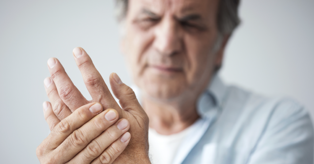 Man with joint pain in his fingers from arthritis
